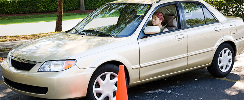 young driver taking safe driver training course