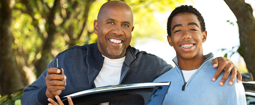 father with teen son who has his own car insurance policy