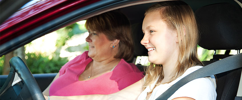 mother with young daughter on her own auto insurance plan
