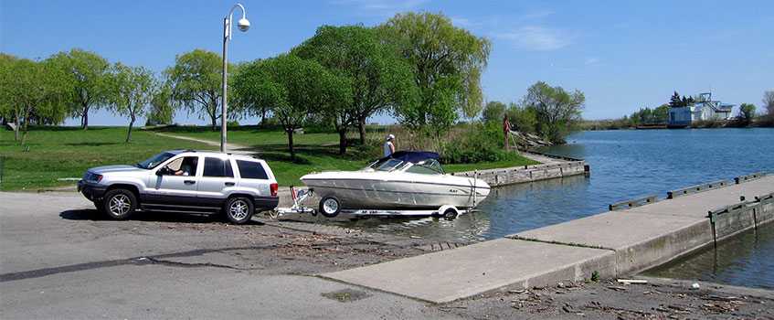 a boat being towed out of water covered by boat insurance policy