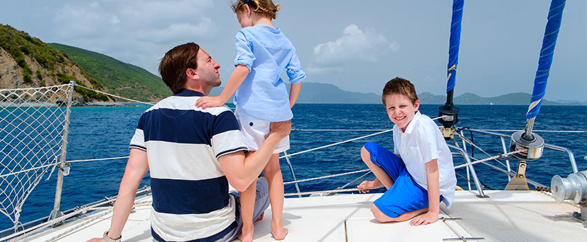 family on yacht with comprehensive boating insurance coverage