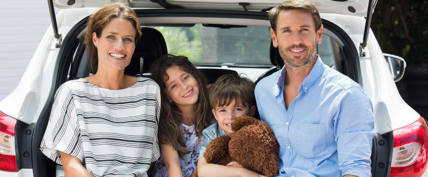 family working with a local car insurance agent