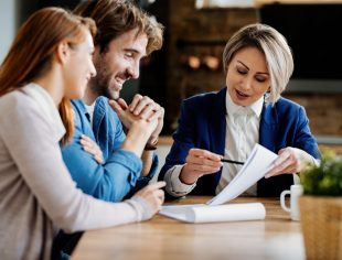Local insurance agency - Agent meeting with clients